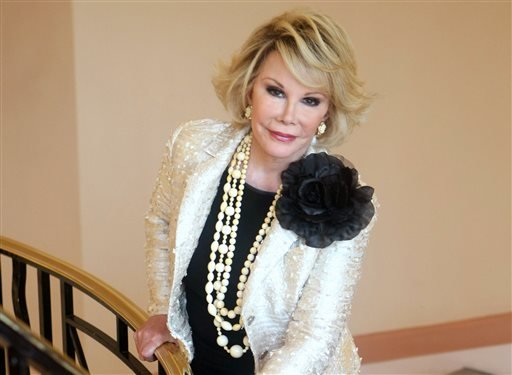 """This Oct. 5, 2009 file photo shows Joan Rivers posing as she presents """"Comedy Roast with Joan Rivers """" during the 25th MIPCOM (International Film and Programme Market for TV, Video, Cable and Satellite) in Cannes, southeastern France."""
