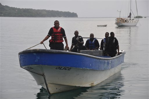Jamaican Marine Police return to the Port Antonio Marina after a fruitless search for a plane that crashed into the ocean near Port Antonio, Jamaica, Friday, Sept. 5, 2014.