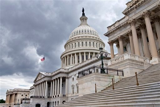 This photo taken July 23, 2013, show the U.S. Capitol in Washington. Congress returns to work this week with a relatively short and simple agenda, vote to keep the government operating in the short term, then return home to campaign.