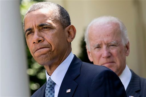 In this June 30, 2014, file photo President Barack Obama, accompanied by Vice President Joe Biden, pauses while making an announcement about immigration reform in the Rose Garden of the White House in Washington.