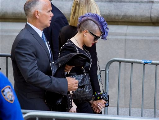 Kelly Osbourne arrives at a funeral service for comedian Joan Rivers at Temple Emanu-El in New York Sunday, Sept. 7, 2014. Rivers died Thursday at 81. (AP Photo/Craig Ruttle)