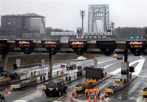 In this Jan. 11, 2014, file photo, traffic passes through the toll booths at the George Washington Bridge, in Fort Lee, N.J. New Jersey Gov. Chris Christie appears to have largely moved past the lane-closing scandal.