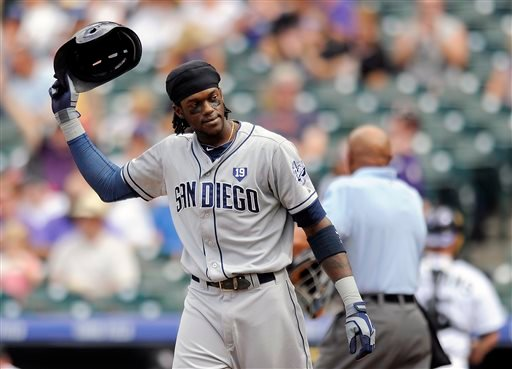 San Diego Padres' Cameron Maybin tosses his helmet after striking out in the second inning of a baseball game against the Colorado Rockies Sunday, Sept. 7, 2014, in Denver. (AP Photo/Chris Schneider)