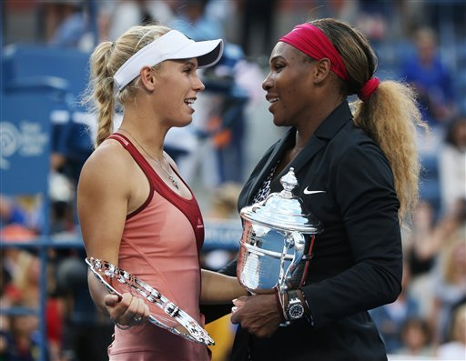 Caroline Wozniacki, of Denmark, left, talks with Serena Williams, of the United States, after Williams won the championship match of the 2014 U.S. Open tennis tournament, Sunday, Sept. 7, 2014, in New York. (AP Photo/Mike Groll)