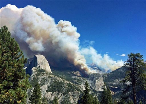 In this photo provided by Yosemite National Park, smoke from a fire rises above Little Yosemite Valley near Yosemite National Park, Calif., Sunday, Sept. 7, 2014.