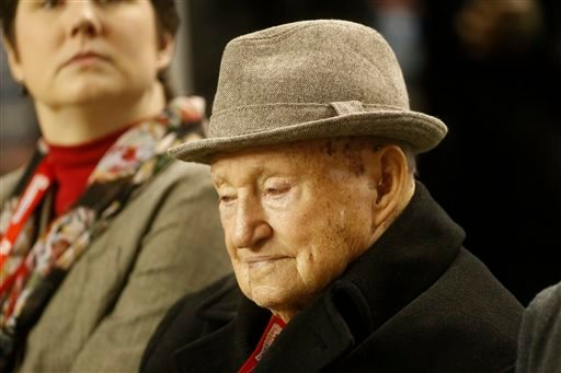 In this Dec. 31, 2012, file photo, S. Truett Cathy the founder of Chick-fil-A watches teams warming up before the first half of the Chick-fil-A Bowl NCAA college football game between Clemson and LSU in Atlanta.