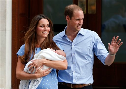 In this Tuesday, July 23, 2013 file photo, Britain's Prince William and Kate, Duchess of Cambridge hold George, the Prince of Cambridge, as they pose for photographers outside St. Mary's Hospital exclusive Lindo Wing in London where the Duchess gave birth