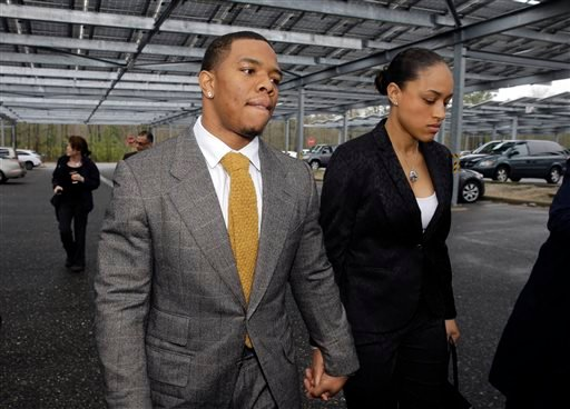 In this May 1, 2014, file photo, Baltimore Ravens football player Ray Rice holds hands with his wife, Janay Palmer, as they arrive at Atlantic County Criminal Courthouse in Mays Landing, N.J.