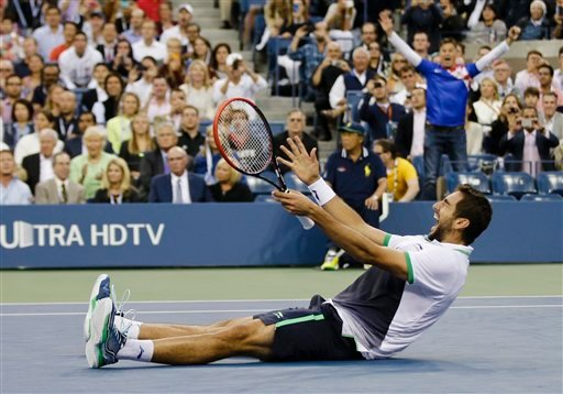 Marin Cilic, of Croatia, reacts after defeating Kei Nishikori, of Japan, during the championship match of the 2014 U.S. Open tennis tournament, Monday, Sept. 8, 2014, in New York. (AP Photo/Darron Cummings)