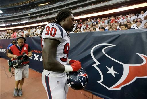Houston Texans' Jadeveon Clowney (90) leaves with a knee injury during the second quarter of an NFL football game against the Washington Redskins, Sunday, Sept. 7, 2014, in Houston.