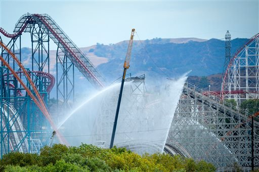 Los Angeles County Fire Department crews respond to a fire on the recently closed Colossus ride at Southern California's Six Flags Magic Mountain park in Valencia, Calif., on Monday, Sep. 8, 2014. (AP)