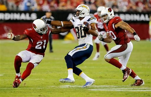 San Diego Chargers wide receiver Malcom Floyd (80) is pursued by Arizona Cardinals inside linebacker Larry Foote (50) and Patrick Peterson (21) during the second half of an NFL football game, Monday, Sept. 8, 2014, in Glendale, Ariz.