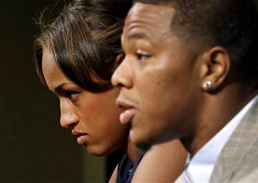 In this May 23, 2014, file photo, Janay Rice, left, looks on as her husband, Baltimore Ravens running back Ray Rice, speaks to the media during a news conference in Owings Mills, Md.