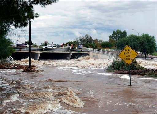 Floodwaters surge Monday, Sept. 8, 2014, in Scottsdale, Ariz.