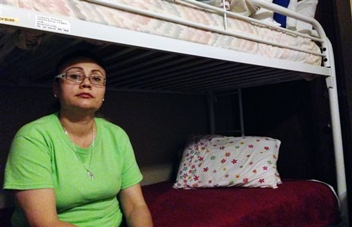 This Sept. 4, 2014 photo shows Rosa Robles Loreta sitting at the Southside Presbyterian Church in Tucson, Ariz. Robles Loreto, a Mexican immigrant who is facing deportation, has moved into the church where she is taking sanctuary.