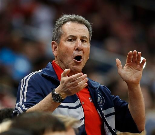 In this April 26, 2014, file photo, Atlanta Hawks co-owner Bruce Levenson cheers from the stands in the second half of Game 4 of an NBA basketball first-round playoff series against the Indiana Pacers in Atlanta.