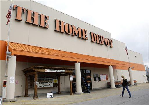 In this Aug. 14, 2012 file photo, a customer walks toward a Home Depot in Nashville, Tenn.
