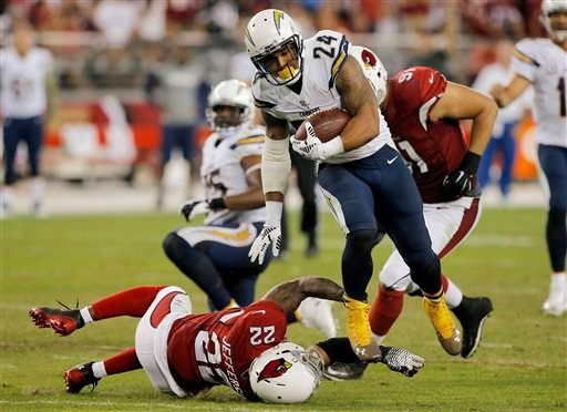 San Diego Chargers running back Ryan Mathews (24) eludes the tackle of Arizona Cardinals free safety Tony Jefferson (22) to score a touchdown during the second half of an NFL football game, Monday, Sept. 8, 2014, in Glendale, Ariz. (AP Photo/Rick Scuteri)