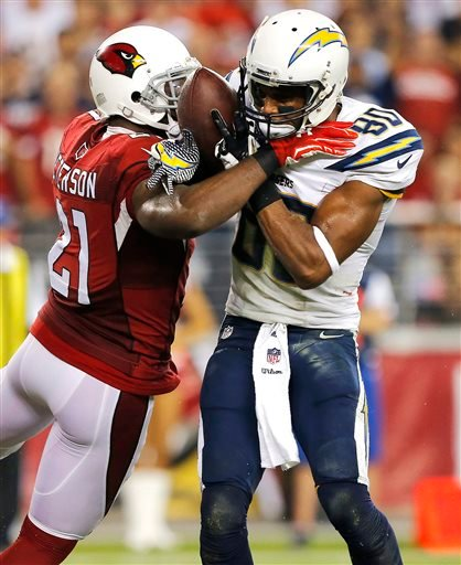 San Diego Chargers wide receiver Malcom Floyd (80) scores a touchdown as Arizona Cardinals cornerback Patrick Peterson (21) defends during the second half of an NFL football game, Monday, Sept. 8, 2014, in Glendale, Ariz. (AP Photo/Rick Scuteri)