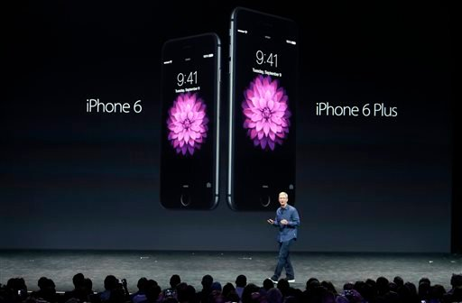 Apple CEO Tim Cook introduces the new iPhone 6 and iPhone 6 Plus on Tuesday, Sept. 9, 2014, in Cupertino, Calif. (AP Photo/Marcio Jose Sanchez)