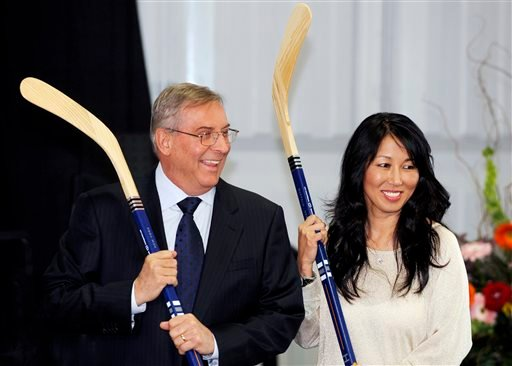 In this April 13, 2013, file photo, Buffalo Sabres' owner Terry Pegula and his wife, Kim Pegula, pose for cameras during groundbreaking ceremonies at First Niagara Center in Buffalo, N.Y.