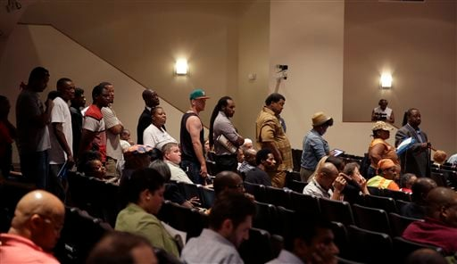 A line of people wait to speak during a meeting of the Ferguson City Council Tuesday, Sept. 9, 2014, in Ferguson, Mo. The meeting is the first for the city council since the fatal shooting of Michael Brown by a city police officer.(AP Photo/Jeff Roberson)