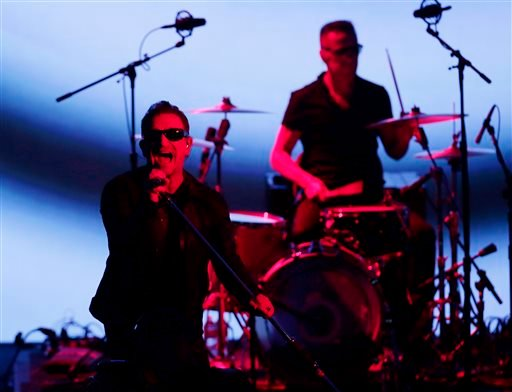 U2 members Bono, left, and Larry Mullen Jr. perform during an announcement of new products by Apple on Tuesday, Sept. 9, 2014, in Cupertino, Calif.