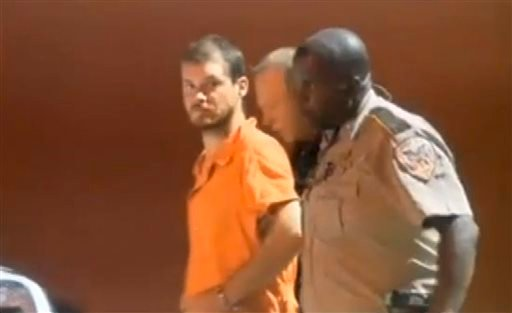 In this image taken from video on Tuesday, Sept. 9, 2014, Smith County Sheriff's Deputies escort Timothy Ray Jones Jr., from jail in Raleigh, Miss.