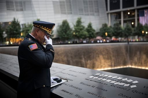 Sam Pulia, mayor of Westchester, Ill., and a former police officer of the same town, mourns over the name of his cousin, New York firefighter Thomas Anthony Casoria. (AP Photo/Andrew Burton, Pool)
