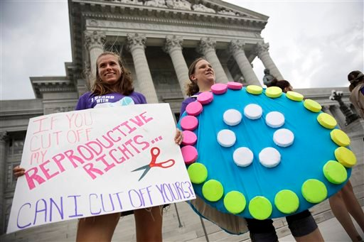 Abortion-rights supporters Dina van der Zalm, right, and Allyson Junker stand on the steps of the Missouri Capitol Sept. 10, 2014, in Jefferson City, Mo. (AP Photo/Jeff Roberson)