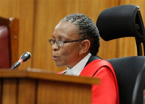 Judge Thokozile Masipa reads notes as she delivers her verdict in the Oscar Pistorius murder trial, in Pretoria, South Africa, Thursday, Sept. 11 2014.
