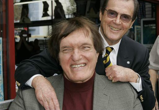 """In this Oct. 11, 2007 file photo, actor Roger Moore, right, who played the part of James Bond 007 in seven films, poses with actor Richard Kiel who played the role of Jaws in """"The Spy Who Loved Me."""""""