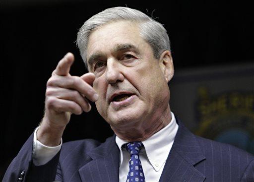 In this Jan. 9, 2011, file photo, FBI Director Robert S. Mueller III speaks in Tucson, Ariz.