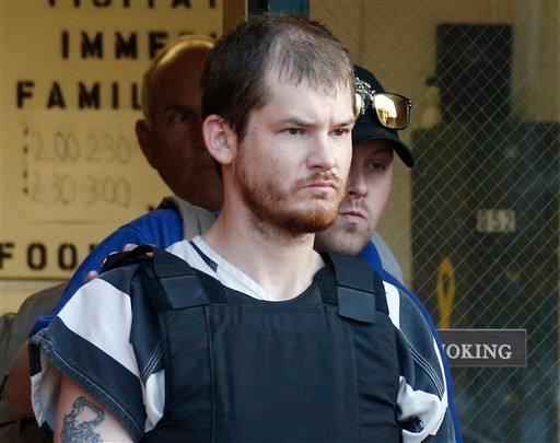 Timothy Ray Jones Jr., is escorted by lawmen out of the Smith County Jail in Raleigh, Miss., Thursday, Sept. 11, 2014. (AP)