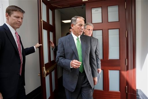 House Speaker John Boehner of Ohio, center, and House Majority Leader Kevin McCarthy of Calif., right, emerge from a two-hour, closed door meeting with fellow Republicans, on Capitol Hill in Washington, Thursday, Sept. 11, 2014. (AP)