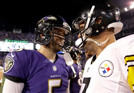 Baltimore Ravens quarterback Joe Flacco, left, and Pittsburgh Steelers quarterback Ben Roethlisberger talk on the field after an NFL football game Thursday, Sept. 11, 2014, in Baltimore. The Ravens won 26-6. (AP Photo/Patrick Semansky)