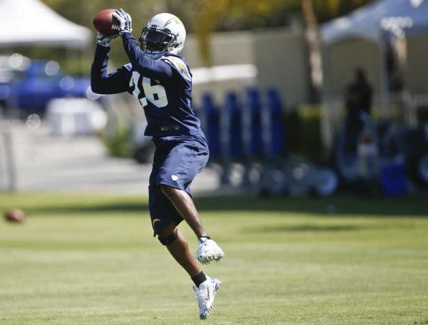 San Diego Chargers defensive back Brandon Flowers picks off a pass during drills at a NFL football training camp Thursday, July 24, 2014, in San Diego.