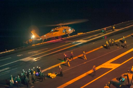 This photo provided by the US Navy, a MH-60S Sea Hawk helicopter lands on the flight deck of the Nimitz-class aircraft carrier USS Carl Vinson (CVN 70) during search and rescue operations for a missing pilot on Friday, Sept. 12, 2014.