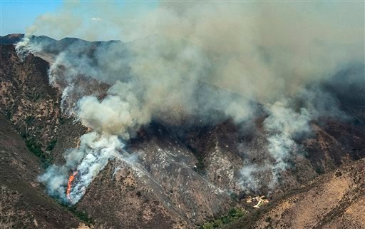 A wildfire burns in Silverado Canyon in eastern Orange County, Calif. on Friday, Sept. 12, 2014. (AP Photo/Orange County Register, Mark Rightmire)
