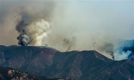 A wildfire burns along a ridge line in the Cleveland National Forest near Silverado Canyon in eastern Orange County, Calif. on Friday, Sept. 12, 2014. (AP Photo/Orange County Register, Mark Rightmire)