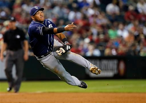 San Diego Padres third baseman Yangervis Solarte makes an off-balance throw for the out against the Arizona Diamondbacks in the first inning during a baseball game, Friday, Sept. 12, 2014, in Phoenix. (AP Photo/Rick Scuteri)