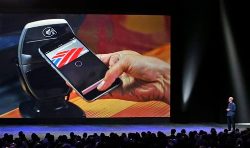 In this Tuesday, Sept. 9, 2014, file photo, Apple CEO Tim Cook introduces the new Apple Pay product in Cupertino, Calif.