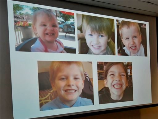 Photos of Timothy Ray Jones Jr. children are on display during a news conference at the Lexington County Sheriff's Dept Training Center in Lexington, S.C., Wednesday, Sept. 10, 2014.