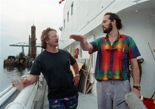 In this June 18, 1991 photo, Tommy Thompson, right, talks with Bob Evans on the Artic Discover as they depart Norfolk,Va.