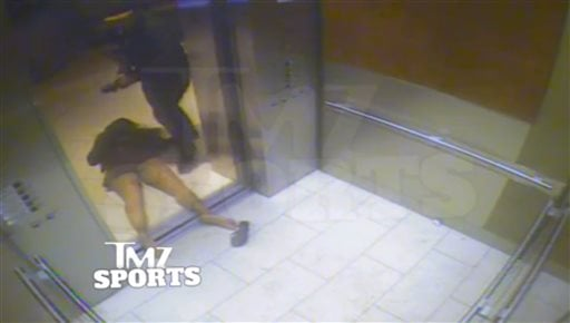 In this February 2014 file photo, from a still image taken from a hotel security video released by TMZ Sports, Baltimore Ravens running back Ray Rice drags his fiancee, Janay Palmer, out of an elevator moments after knocking her off her feet..