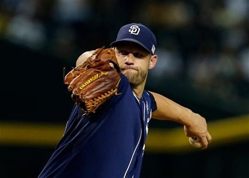 San Diego Padres starting pitcher Eric Stults throws in the first inning during a baseball game against the Arizona Diamondbacks, Friday, Sept. 12, 2014, in Phoenix. (AP Photo/Rick Scuteri)