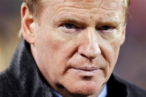 In this Feb. 2, 2014, file photo, NFL Commissioner Roger Goodell takes the field before the NFL Super Bowl XLVIII football game between the Seattle Seahawks and the Denver Broncos in East Rutherford, N.J.