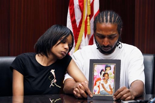 In this May 18, 2010 file photo, Dominika Stanley, left, the mother of 7-year-old Aiyana Jones sits next to Aiyana's father Charles Jones in attorney Geoffrey Fieger's office in Southfield, Mich.