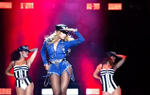 Beyonce and JAY Z perform during the Beyonce and Jay Z - On the Run tour at Stade De France on Friday, Sept. 13, 2014, in Paris, France. (Photo by Rob Hoffman/Invision for Parkwood Entertainment/AP Images)