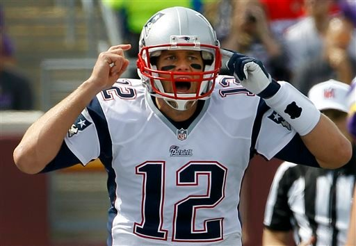 New England Patriots quarterback Tom Brady yells on the line of scrimmage during the first quarter of an NFL football game against the Minnesota Vikings, Sunday, Sept. 14, 2014, in Minneapolis. (AP Photo/Ann Heisenfelt)
